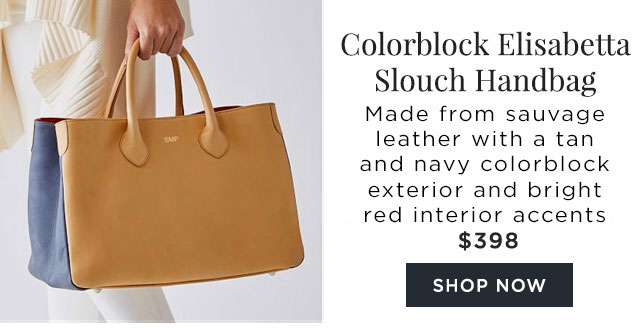 Colorblock Elisabetta Slouch Handbag - This latest addition features a tan and navy colorblock exterior with a bright red interior accent. - $398 - SHOP NOW