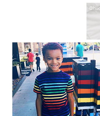 photo of child in navy rainbow stripe tee