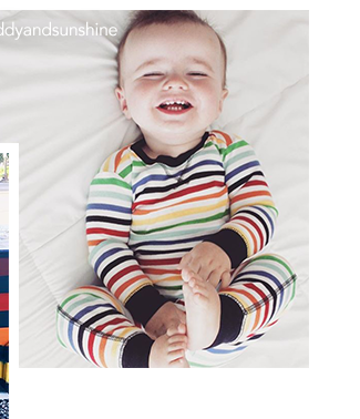 photo of baby wearing rainbow stripe pjs