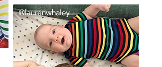 a baby and older child wearing matching navy rainbow stripe styles