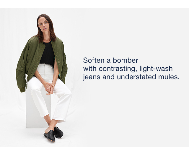 Soften a bomber with contrasting, light-wash jeans and understated mules.