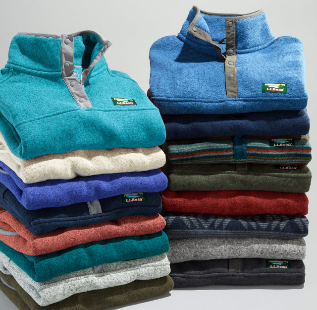 Two stacks of Sweater Fleece in an assortment of colors.