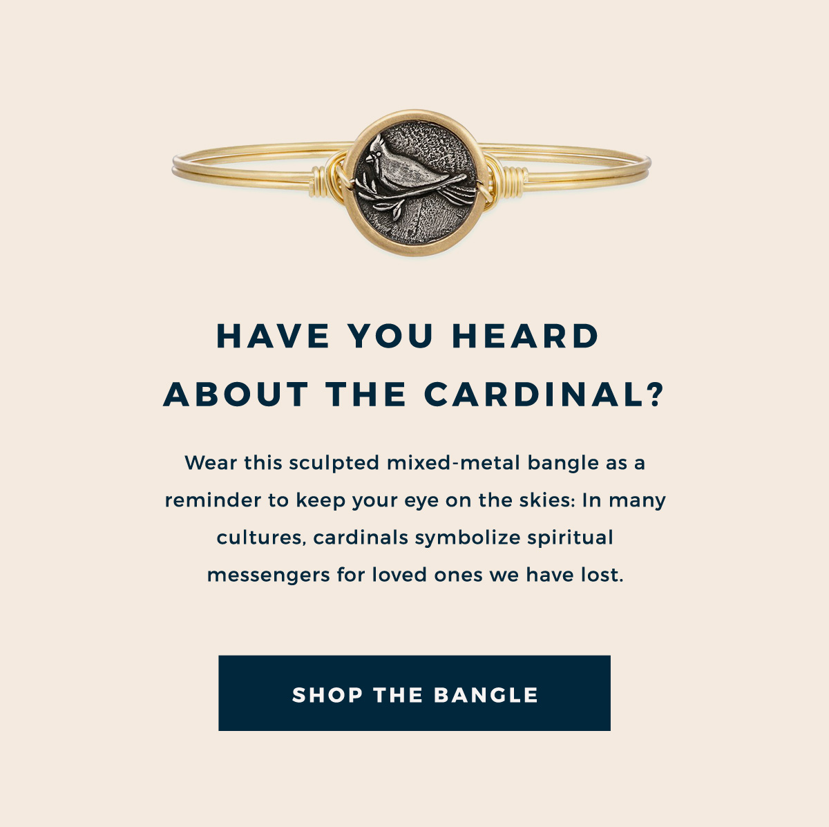 HAVE YOU HEARD ABOUT THE CARDINAL? | Wear this sculpted mixed-metal bangle as a reminder to keep your eye on the skies: In many cultures, cardinals symbolize spiritual messengers for loved ones we have lost. | SHOP THE BANGLE
