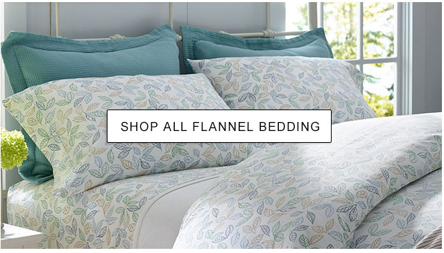 A bed made up with flannel bedding.