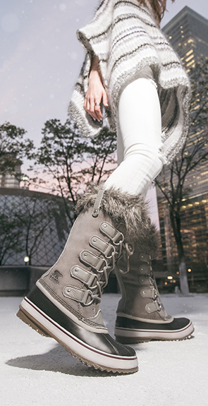 Woman wearing Joan of Arctic boots in a snowy setting
