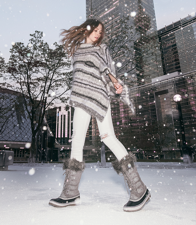 Woman wearing Joan of Arctic boots in a snowy city setting
