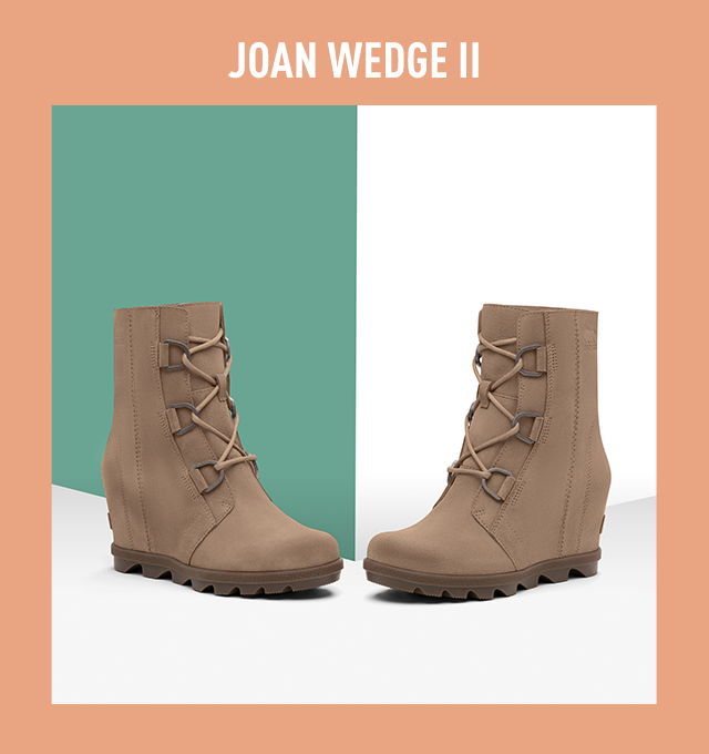 A pair of Joan Wedge II boots on a blue and white background