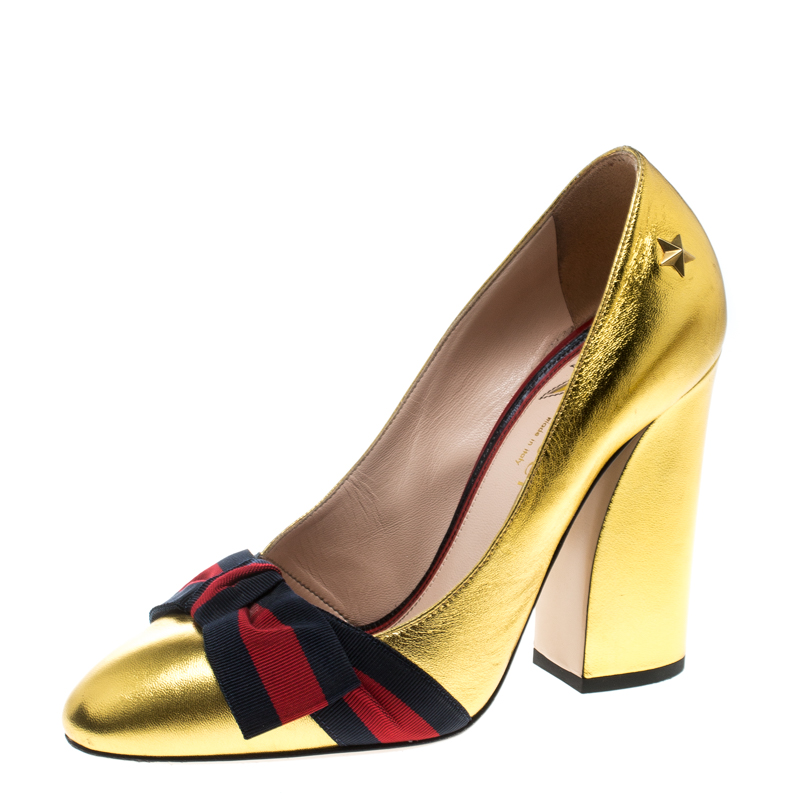 89ce24bb9eb4 Gucci Metallic Gold Leather Web Bow Detail Pumps