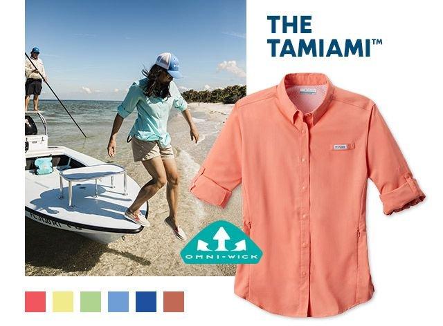 A woman fishing in a Tamiami shirt, Omni-Wick tech logo.