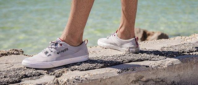 A man wearing fishing shoes.