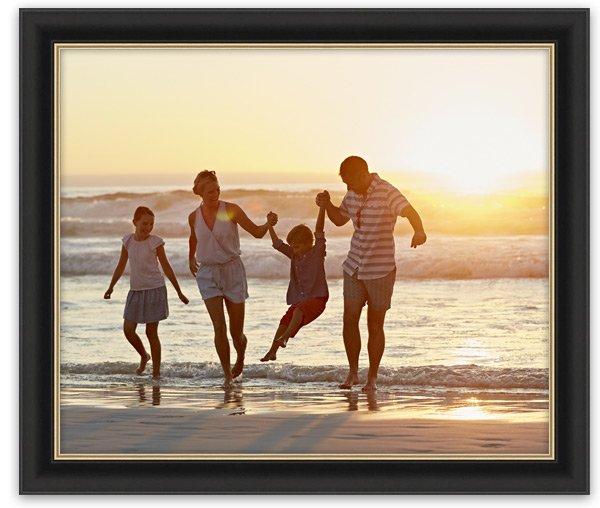 Beach family photo framed in black and gold EWB9 frame.
