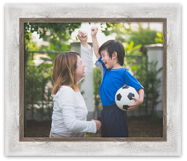 Photo of a mom and son celebrating a soccer win, framed in whitewash barnwood frame.