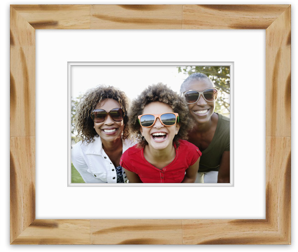 Fun candid photo of granddaughter, mother and grandmother together framed in Nordic Pines.