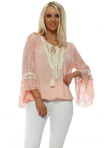 Pink Top With Flared Lace Sleeves