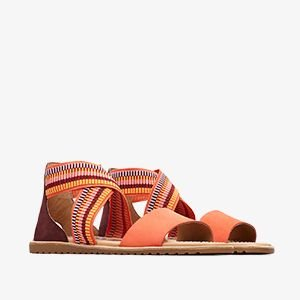 Coral colored Ella sandals on a white background