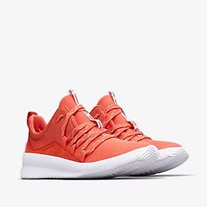 Coral colored Out N About sneakers on a white background