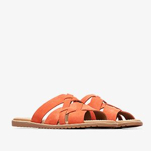 Coral colored Out N About sandals on a white background