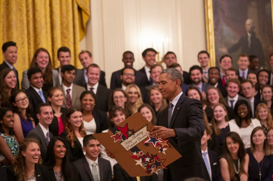 President Obama receiving his birthday card from the White House interns.