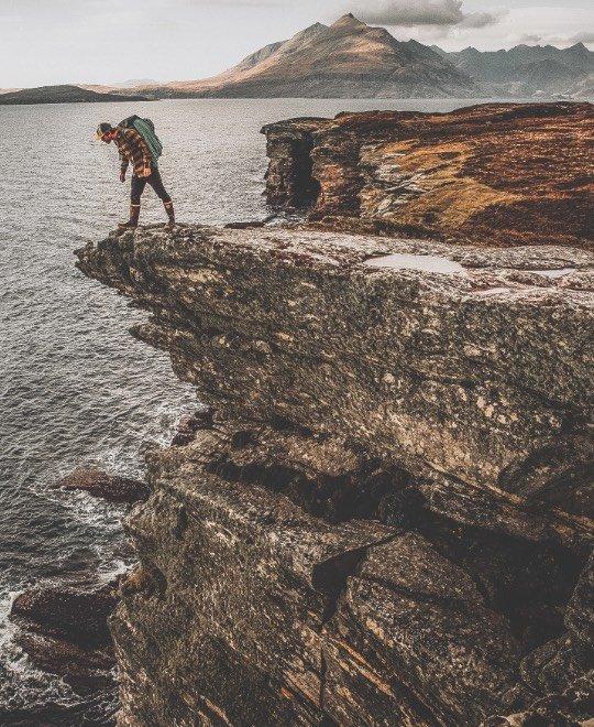 Climbing the cliffs of Elgol