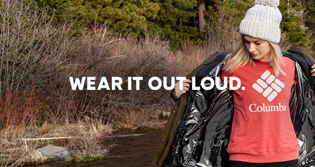 Wear it out loud. A woman outdoors in Columbia Logo Wear.