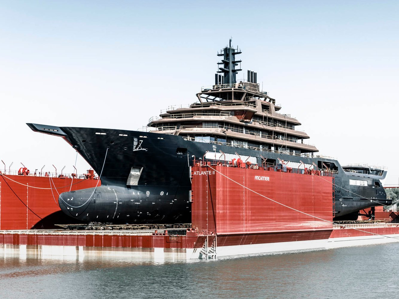 A sleek black yacht that just launched is now the world's largest superyacht. Take a look at the 600-foot vessel owned by a Norwegian billionaire.