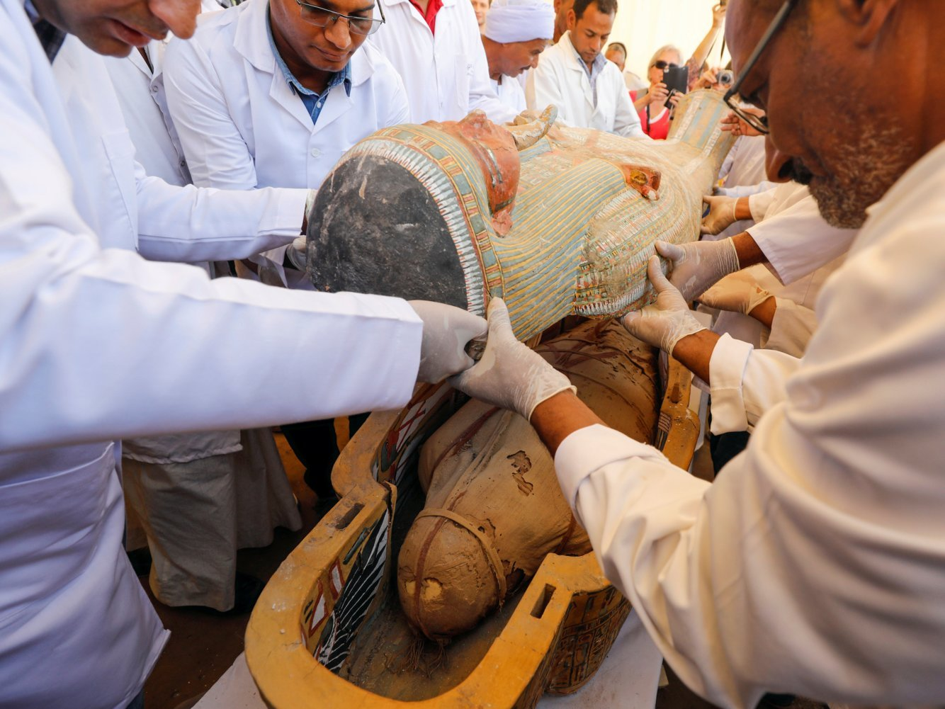 Archaeologists discovered 30 ancient sarcophagi in Egypt with perfectly preserved mummies inside. Photos show the biggest coffin find in a century.