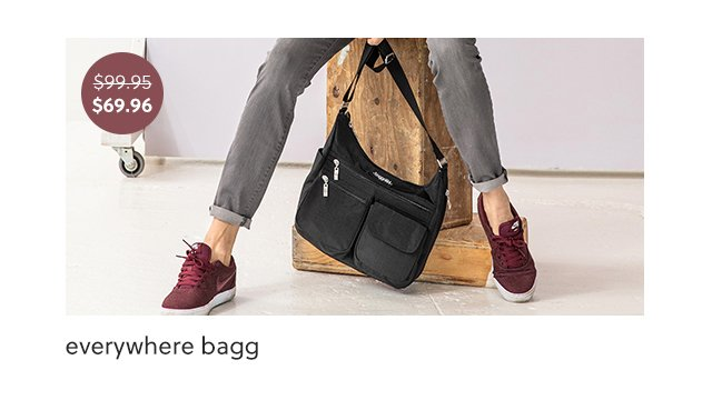 A woman sitting holding the everywhere bagg for 30 percent off