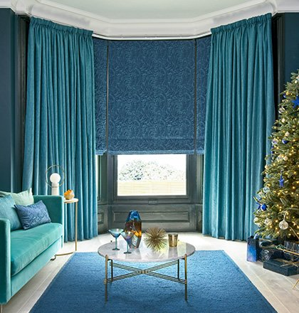 Teal coloured curtains with blue blinds