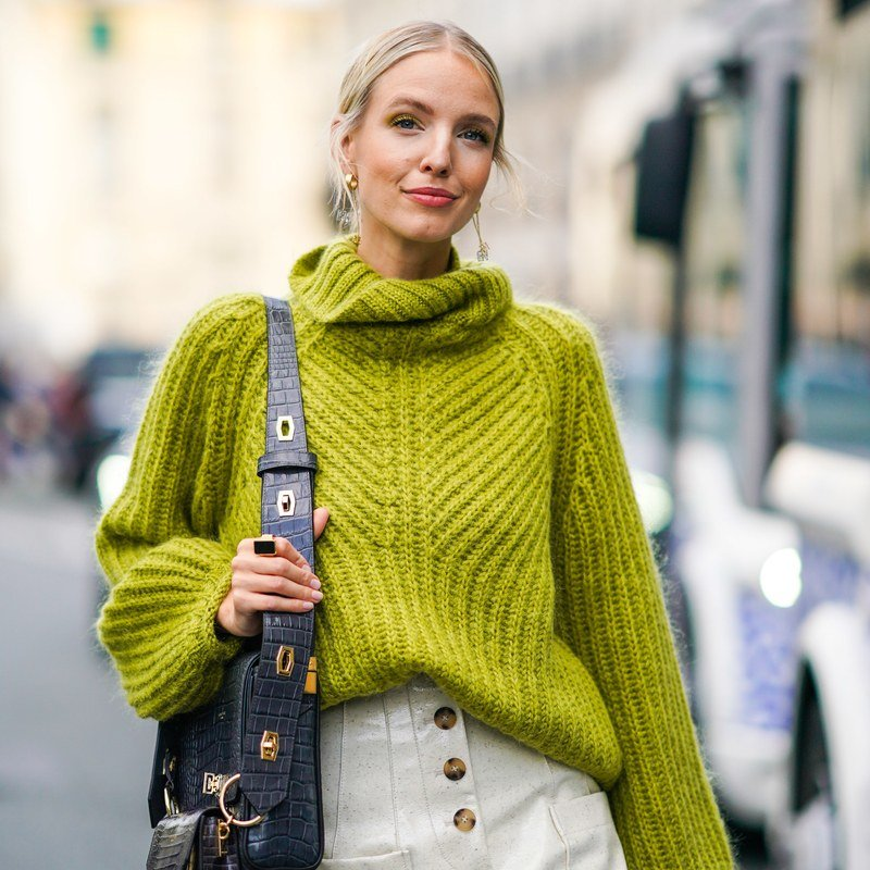 Leonie Hanne wears sunglasses, oversized sweaters, a Givenchy bag, white skirt, outside Beautiful People, during Paris Fashion Week - Womenswear Spring Summer 2020, on September 30, 2019 in Paris, France.