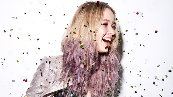 Image of model with French Manicure Hair in blonde and purple for the holidays.