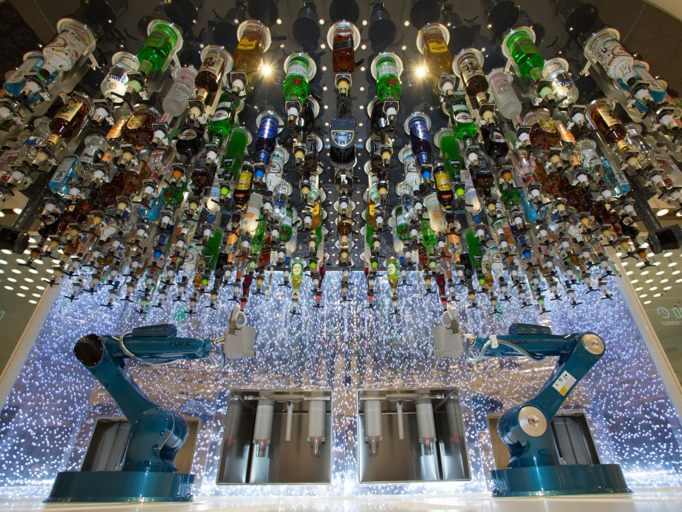 The world's biggest cruise ship has robot bartenders, a water slide with a 92-foot drop, and a nine-story zip-line — here's what it looks like