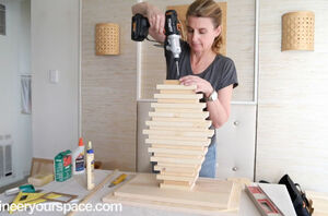 She saved up all her pieces of scrap wood for an incredible bedroom idea