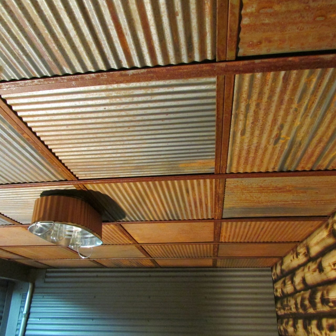 Image of: Decorative Ceiling Tiles Inc Going Rustic Corrugated Metal And Faux Wood Beams Milled